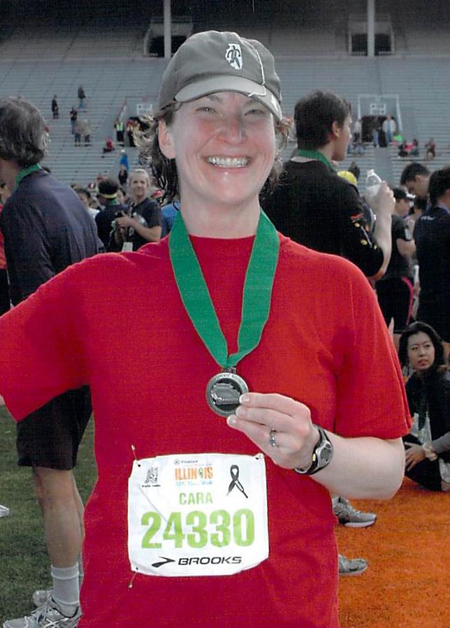 Cara finishing a 10K in April 2013