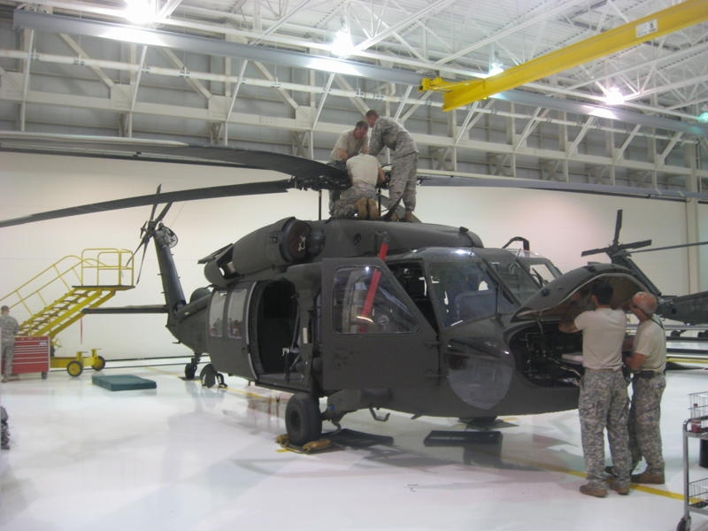 Soldiers at work on a UH-60 Blackhawk helicopter in Missouri